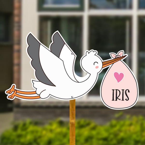 Geboortebord voor in de tuin - Vliegende ooievaar met naam baby - Roze